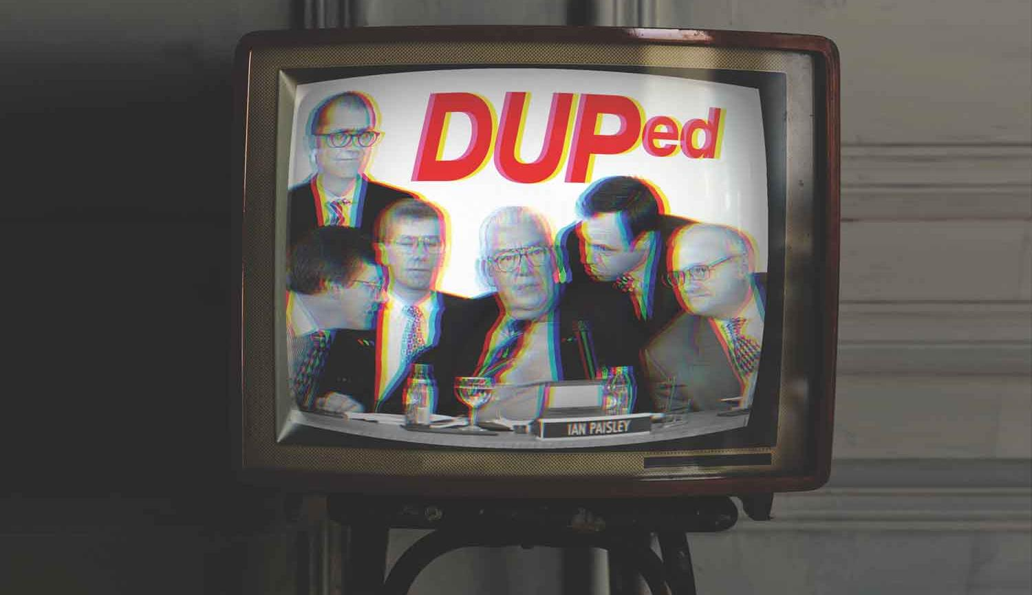 Photo of old style TV with Ian Paisley surrounded by five men on the screen