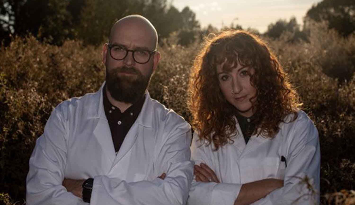 Findlay Napier and Megan Henwood standing side by side wearing white lab coats