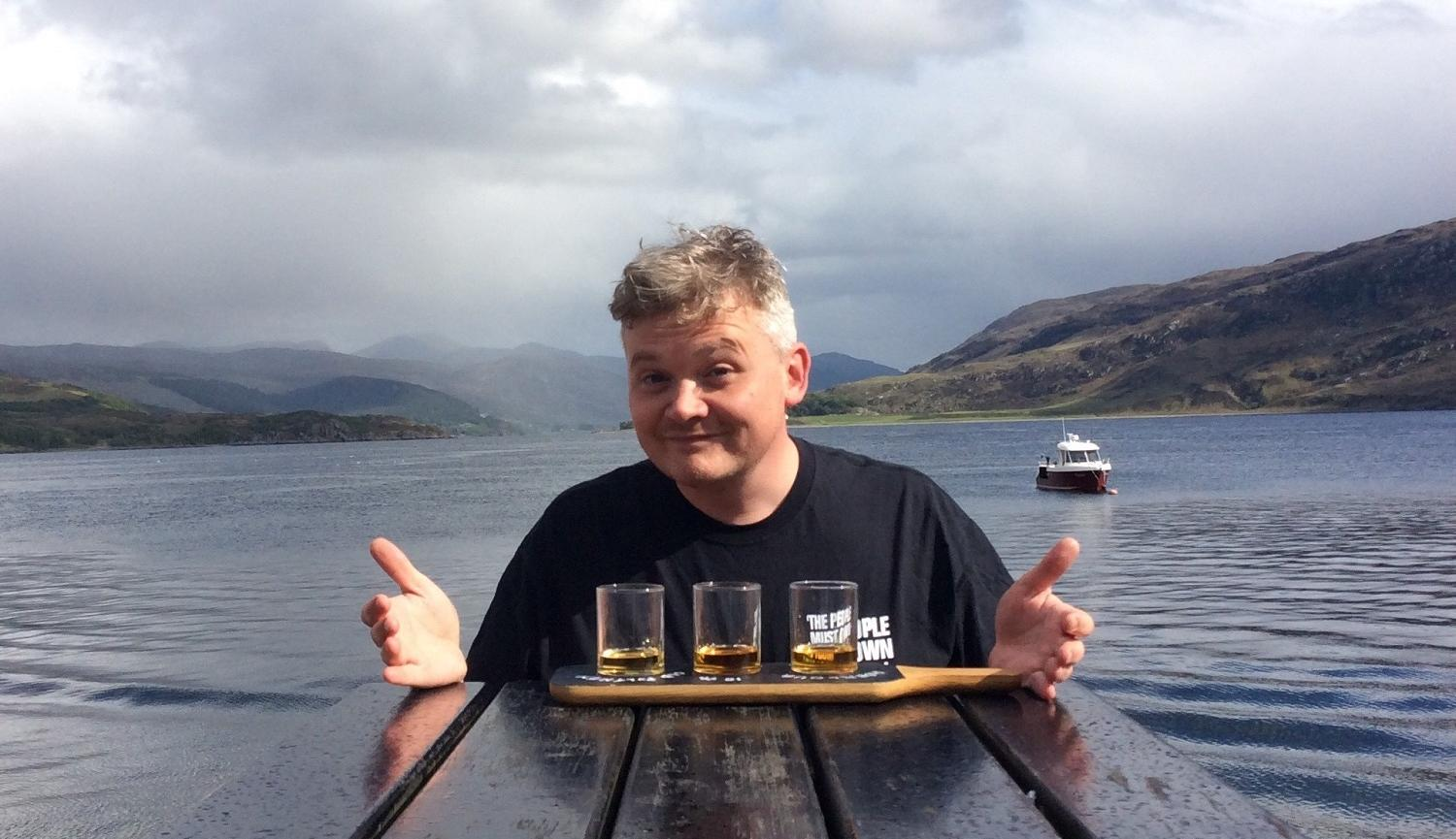 Joe Douglas by Loch with Whisky taster glasses