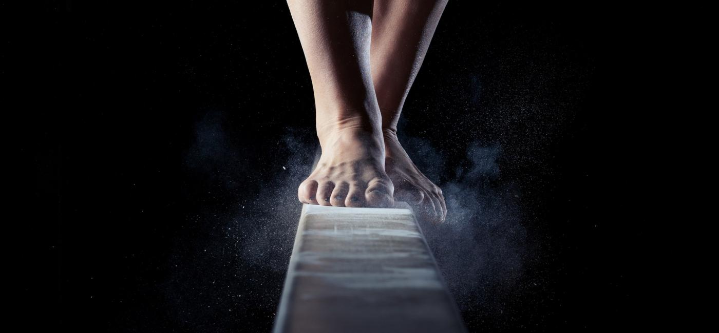 Image of feet walking on a barre