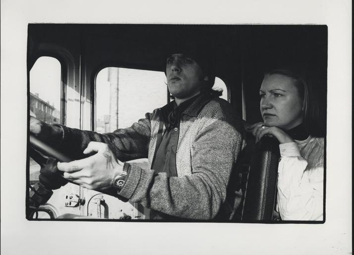 Photo from 1970s of man and woman driving van