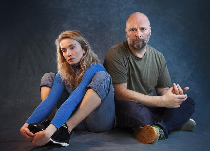Photo of man and girl sitting on floor