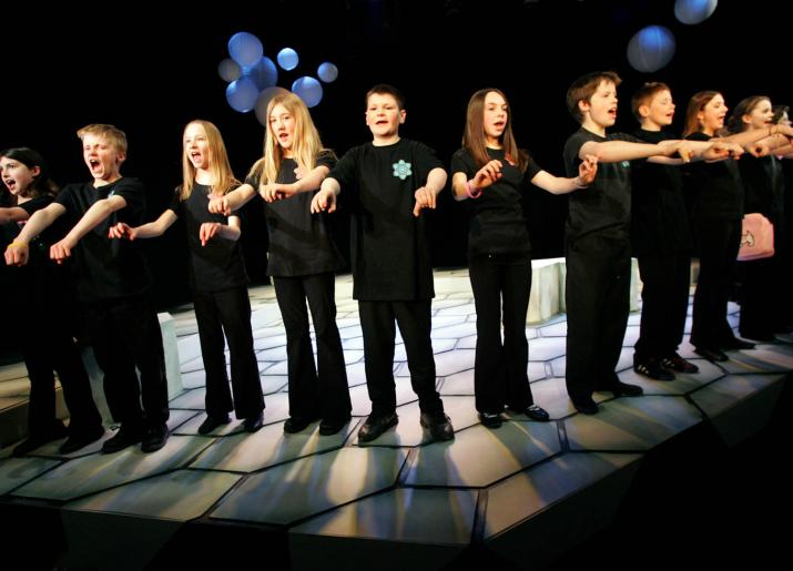 Artsmark, group of children on stage